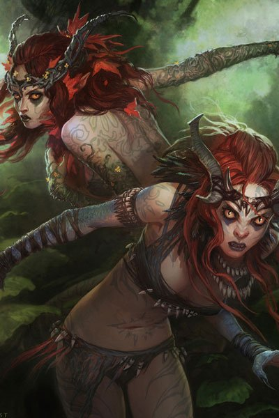 Two wild women with long red hair, yellow eyes and elaborate tattoos.
