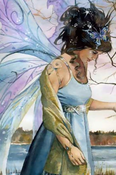 A dark-haired fairy in a gauzy dress in a reflective mood.