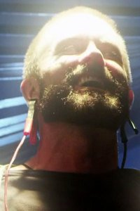 Garret Dillahunt as the spiritual guide Hogan.