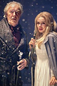 Kazran Sardick (Michael Gambon) and Abigail (Katherine Jenkins) stand in the snow.