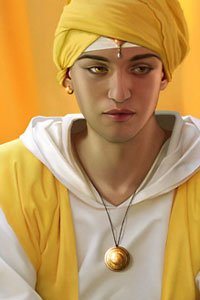 A young prince in white robes and a yellow turban.