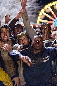 A horde of zombies swarm Zombieland's Pacific Playland.