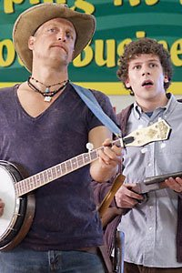 Tallahassee and Columbus (Woody Harrelson and Jesse Eisenberg) prepare for zombie combat in a Zombieland grocery store.